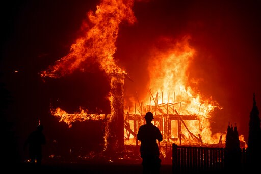 (AP Photo/Noah Berger,File). FILE - In this Nov. 8, 2018 file photo a home burns as the Camp Fire rages through Paradise, Calif. California fire authorities say that Pacific Gas and Electric equipment was responsible for the deadliest and most destruct...