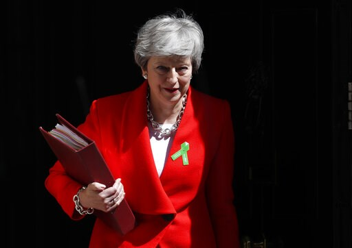 (AP Photo/Alastair Grant). Britain's Prime Minister Theresa May leaves 10 Downing Street for her weekly Prime Minister's Questions in the House of Commons in London, Wednesday, May 15, 2019.