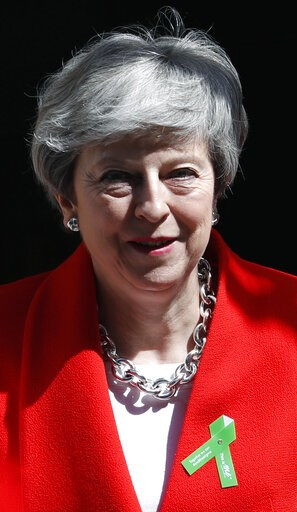 (AP Photo/Alastair Grant). Britain's Prime Minister Theresa May leavse 10 Downing Street for her weekly Prime Minister's Questions at the House of Commons in London, Wednesday, May 15, 2019.
