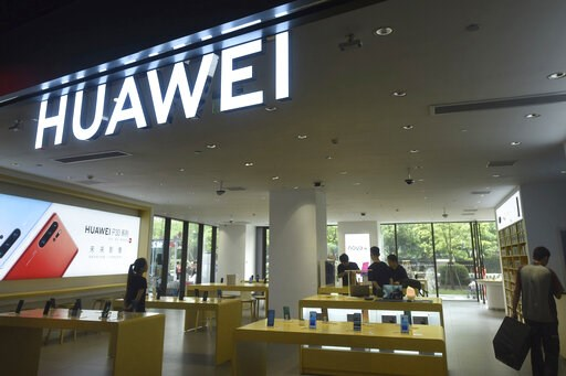 (Chinatopix via AP). Shoppers browse smartphones at a Huawei retail store in Hangzhou in eastern China's Zhejiang province, Thursday, May 16, 2019. In a fateful swipe at telecommunications giant Huawei, the Trump administration issued an executive orde...