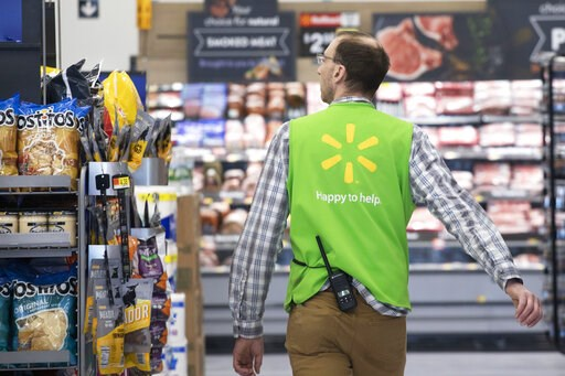 (AP Photo/Mark Lennihan, File). FILE - In this April 24, 2019, file photo a Walmart associate works at a Walmart Neighborhood Market in Levittown, N.Y. Walmart Inc. reports earnings on Thursday, May 16.