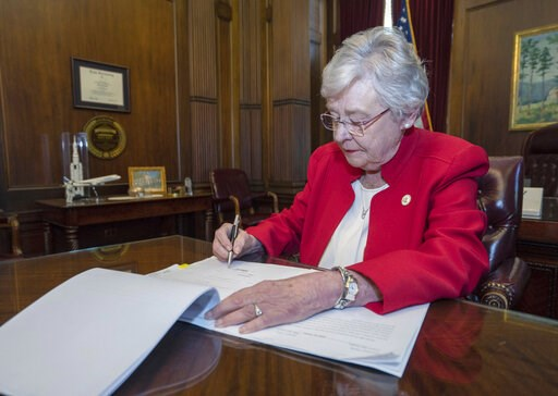 (Hal Yeager/Alabama Governor's Office via AP). This photograph released by the state shows Alabama Gov. Kay Ivey signing a bill that virtually outlaws abortion in the state on Wednesday, May 15, 2019, in Montgomery, Ala. Republicans who support the mea...