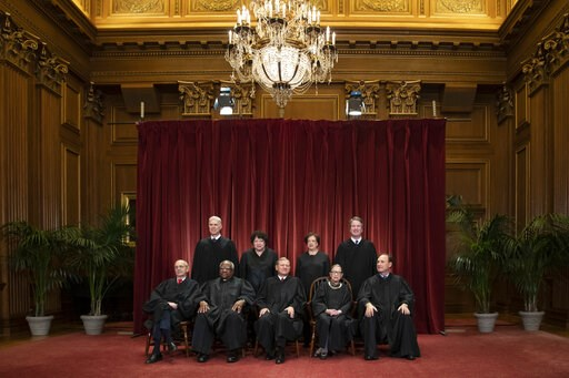 (AP Photo/J. Scott Applewhite, File). FILE - In this Nov. 30, 2018, file photo, the justices of the U.S. Supreme Court gather for a formal group portrait to include a new Associate Justice, top row, far right, at the Supreme Court Building in Washingto...