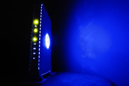 (AP Photo/Matt Rourke, File). FILE- This July 27, 2008, file photo shows a, LED-illuminated wireless router in Philadelphia. Officials from the United States and Europe are announcing charges against 10 people in connection with malicious software atta...