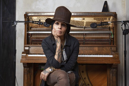 (Photo by Rebecca Cabage/Invision/AP). In this Jan. 23, 2019 photo, Linda Perry poses for a portrait at her studio in Los Angeles. A benefit gala honoring Linda Perry will include a performance by Rock and Roll Hall of Famers Cheap Trick and appearance...