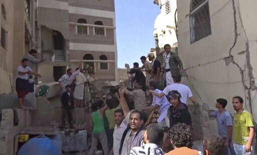 (AP Photo). In this frame grab from from video, people search in the rubble following Saudi-led coalition airstrikes that killed at least six, including children, officials said, in the residential center of the capital, Sanaa, Yemen, Thursday, May 16,...