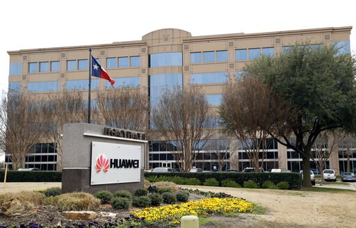 (AP Photo/Tony Gutierrez, File). FILE - In this Thursday, March 7, 2019 file photo, the Texas state flag files outside the Huawei Technologies Ltd. business location in Plano, Texas. President Donald Trump issued an executive order Wednesday, May 15, 2...