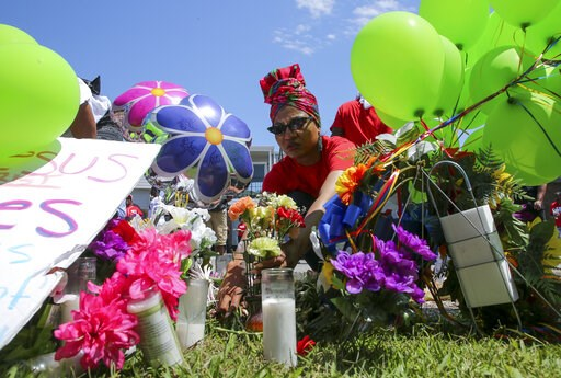 (Godofredo A Vasquez/Houston Chronicle via AP)/Houston Chronicle via AP). Ahsaki Chachere arranges flowers Wednesday, May 15, 2019, at the memorial for Pamela Turner, who was killed Monday night during a confrontation with a Baytown Police officer at T...