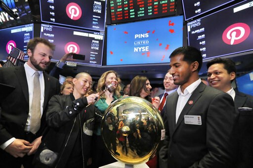 (AP Photo/Richard Drew, File). FILE - In this Thursday, April 18, 2019, file photo, Pinterest co-founder and chief product officer Evan Sharp, left, and fellow co-founder & CEO Ben Silbermann, right, watch as company communications manager Enid Hwa...