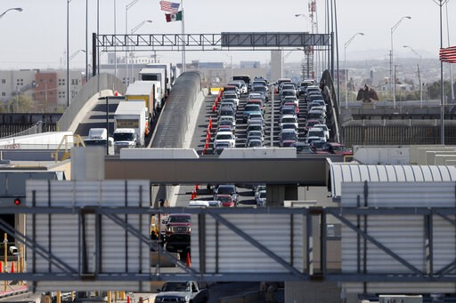 (AP Photo/Gerald Herbert, File). FILE - In this March 29, 2019 file photo, cars and trucks line up to enter the U.S. from Mexico at a border crossing in El Paso, Texas. A 2½-year-old Guatemalan child has died after crossing the border, becoming the fou...