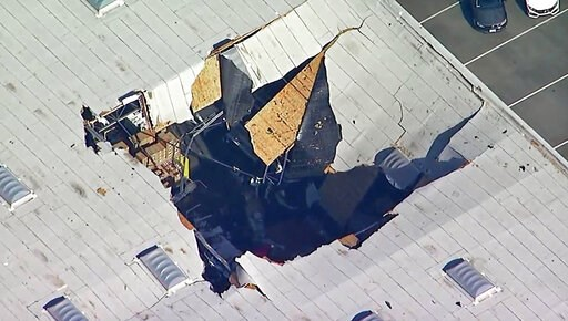 (KABC-TV via AP). This photo taken from video provided by KABC-TV shows where an F-16 fighter jet crashed into a warehouse just outside March Air Reserve Base in Riverside, Calif., Thursday afternoon, May 16, 2019. Maj. Perry Covington, director of pub...