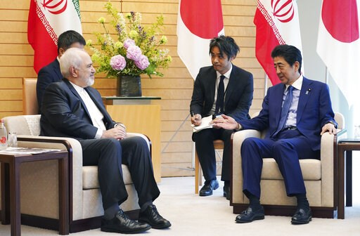 (AP Photo/Eugene Hoshiko, Pool). Iranian Foreign Minister Mohammad Javad Zarif, left, and Japanese Prime Minister Shinzo Abe, right, speak at Abe's official residence in Tokyo Thursday, May 16, 2019. Iran's foreign minister has said his country is comm...