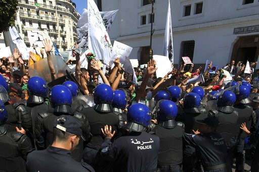 (AP Photo/Fateh Guidoum). Algerian students face riot police officers during an anti-government demonstration in Algiers, Tuesday, May 14, 2019. Former Algerian President Abdelaziz Bouteflika resigned April 2 2019 under pressure from the protesters, an...