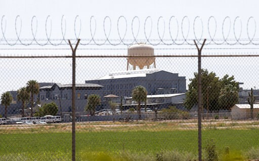(AP Photo/File). FILE - This July 23, 2014 file photo shows a state prison in Florence, Ariz. In May 2019, Corizon Health Inc. and Corizon LLC that provide health care in jails and prisons across the United States, including this one in Florence, have ...