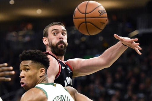 (Frank Gunn/The Canadian Press via AP). Toronto Raptors center Marc Gasol (33) throws a pass as Milwaukee Bucks forward Giannis Antetokounmpo (34) defends during the second half of Game 2 of the NBA basketball playoffs Eastern Conference finals, Friday...