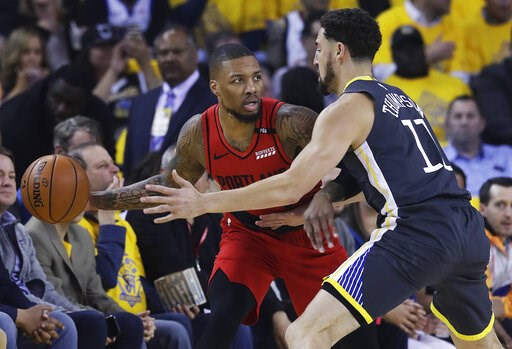 (AP Photo/Jeff Chiu). Portland Trail Blazers guard Damian Lillard, left, is defended by Golden State Warriors guard Klay Thompson during the first half of Game 2 of the NBA basketball playoffs Western Conference finals in Oakland, Calif., Thursday, May...