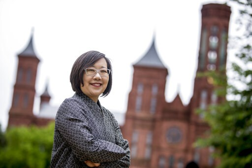 (AP Photo/Andrew Harnik). Lisa Sasaki, the director of the Smithsonian Asian Pacific American Center, poses for a photograph in front of the Smithsonian Castle on the National Mall in Washington, Monday, May 13, 2019. On May 18, the Smithsonian Asian P...