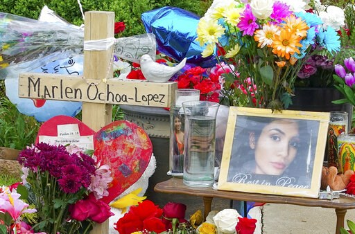 (AP Photo/Teresa Crawford). A memorial of flowers, balloons, a cross and photo of victim Marlen Ochoa-Lopez, are displayed on the lawn, Friday, May 17, 2019 in Chicago, outside the home where Ochoa-Lopez was murdered last month. Assistant State's Attor...