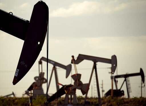 (AP Photo/Charlie Riedel, File). FILE - In this April 24, 2015, file photo, pumpjacks work in a field near Lovington, N.M. Two New Mexico counties remain among the top oil-producing counties in the U.S., according to new federal numbers released in May...