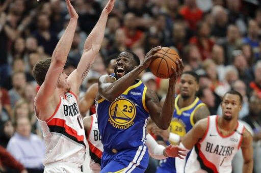 (AP Photo/Ted S. Warren). Golden State Warriors forward Draymond Green (23) shoots against Portland Trail Blazers forward Meyers Leonard, left, during the first half of Game 3 of the NBA basketball playoffs Western Conference finals, Saturday, May 18, ...