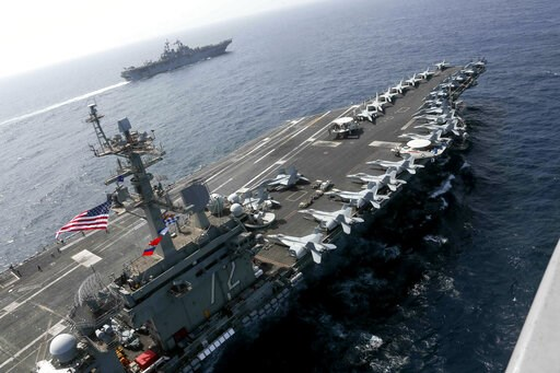 (Mass Communication Specialist 1st Class Brian M. Wilbur, U.S. Navy via AP). CORRECTS DATE - In this Friday, May 17, 2019, photo released by the U.S. Navy, the USS Abraham Lincoln sails in the Arabian Sea near the amphibious assault ship USS Kearsarge....
