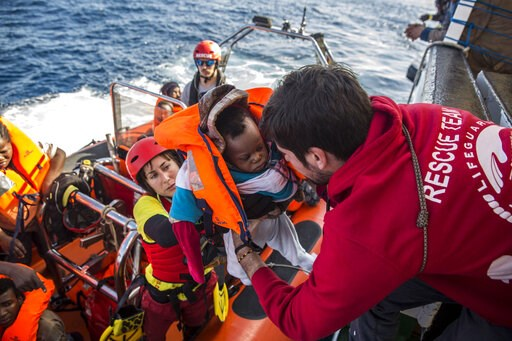 (AP Photo/Olmo Calvo, File). FILE - In this Friday, Dec. 21, 2018 file photo, a baby is loaded into the rescue vessel of the Spanish NGO Proactiva Open Arms, after being rescued in the Central Mediterranean Sea at 45 miles (72 kilometers) from Al Khums...