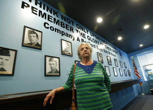 (AP Photo/Steve Helber). In this May 6, 2019, photo, Marguerite Cottrell, sister of John Reynolds, speaks during an interview at a recently opened tribute center for the Bedford Boys in Bedford, Va. Reynolds, had been killed in the D-Day invasion of No...