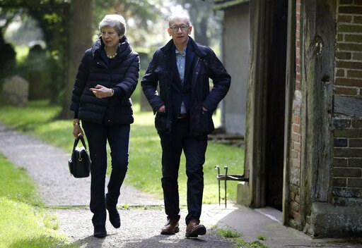 (Andrew Matthews/PA via AP). Britain's Prime Minister Theresa May with her husband Philip leave after a church service near her Maidenhead constituency, England, Sunday May 19, 2019.