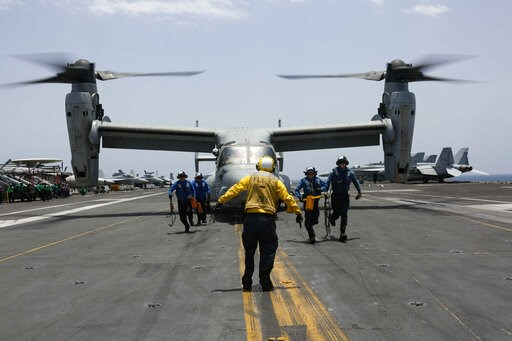 (Mass Communication Specialist 3rd Class Amber Smalley/U.S. Navy via AP). CORRECTS DATE -  In this Friday, May 17, 2019, photo, released by the U.S. Navy, sailors work around an MV-22 Osprey as it lands on the flight deck of the Nimitz-class aircraft c...