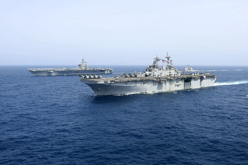 (Mass Communication Specialist 1st Class Brian M. Wilbur, U.S. Navy via AP). CORRECTS DATE - In this Friday, May 17, 2019, photo released by the U.S. Navy, the amphibious assault ship USS Kearsarge sails in front of the USS Abraham Lincoln aircraft car...