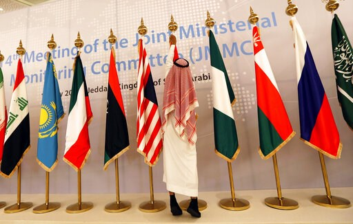 (AP Photo/Amr Nabil). A Saudi worker adjusts flags of participating countries before a meeting of energy ministers from OPEC and its allies to discuss prices and production cuts, in Jiddah, Saudi Arabia, Sunday, May 19, 2019. The meeting takes places a...