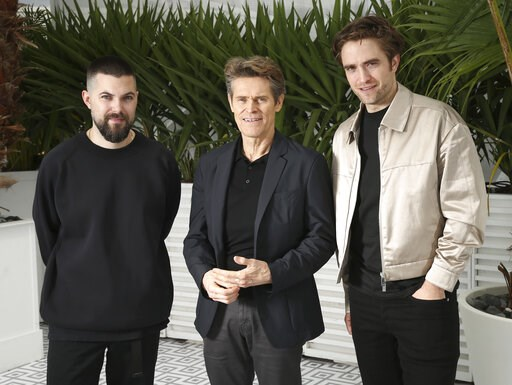 (Photo by Joel C Ryan/Invision/AP). Director Robert Eggers, from left, actors Willem Dafoe and Robert Pattinson pose for portrait photographs for the film 'The Lighthouse' at the 72nd international film festival, Cannes, southern France, Sunday, May 19...