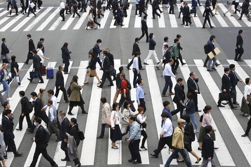 (AP Photo/Koji Sasahara). In this April 15, 2019, photo, people cross the street in Tokyo. The Japanese government says the economy grew at an annual pace of 2.1% in the first quarter, marking the second straight quarter of expansion. The Cabinet Offic...