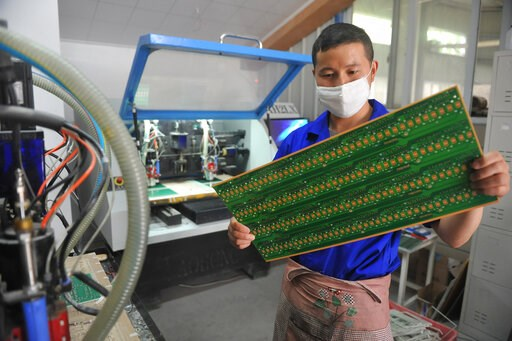 (Chinatopix via AP, File). FILE - In this May 22, 2018 file photo, a staff member works in a circuit board manufacturing facility in Hangzhou in eastern China's Zhejiang province. In a report issued Monday, May 20, 2019, a business group says the numbe...