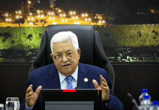 (AP Photo/Majdi Mohammed, Pool, File). FILE - In this April 29, 2019, file photo, Palestinian President Mahmoud Abbas, center, chairs a session of the weekly cabinet meeting in the West Bank city of Ramallah. The Trump administration will unveil the fi...