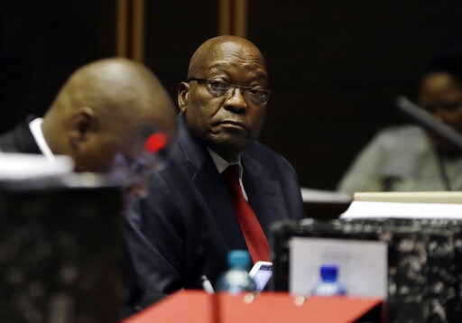 (AP Photo/Themba Hadebe, Pool). Former South African President Jacob Zuma, right, in the High Court in Pietermaritzburg, South Africa, Monday May 20, 2019. Zuma is appearing for four days this week seeking a stay of prosecution on charges of corruption.
