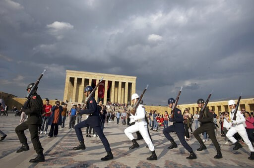 (AP Photo/Burhan Ozbilici). Soldiers march during a changing of guard ceremony as thousands of people visit the mausoleum of Mustafa Kemal Ataturk, the founder of modern Turkey, to pay respect on the day marking the 100th anniversary of the start of Tu...