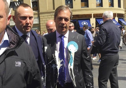 (Tom Wilkinson/PA via AP). Britain's Nigel Farage after being hit with a milkshake during a campaign walkabout in Newcastle, England, Monday May 20, 2019.