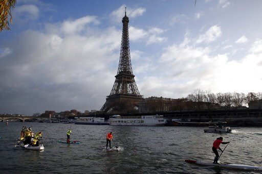 (AP Photo/Christophe Ena, File). FILE - In this Dec.9, 2018 file photo, competitors paddle on the Seine river in front of the Eiffel Tower in Paris. The Eiffel Tower press office said Monday May 20, 2019 an unidentified individual tried to scale the ne...