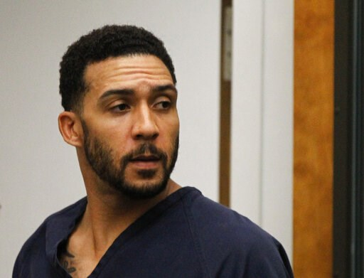 (Hayne Palmour/San Diego Union-Tribune via AP, Pool, File). FILE - In this June 15, 2018, file photo, former NFL football player Kellen Winslow Jr., center, leaves his arraignment in Vista, Calif. Winslow, a former NFL No. 1 draft pick and son of a Hal...