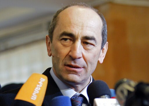 (AP Photo/Misha Japaridze, File). FILE- In this file photo dated Tuesday, Feb. 19, 2008, Armenia's President Robert Kocharian talks to the media at a polling station in Yerevan, Armenia. A court in Armenia has freed the country's former president from ...