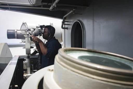 (Mass Communication Specialist 3rd Class Garrett LaBarge/U.S. Navy via AP). In this Sunday, May 19, 2019, photo released by the U.S. Navy, Boatswain's Mate Seaman Tabari Harvey, from Bellevue, Neb., stands watch as forward lookout on vulture's row aboa...