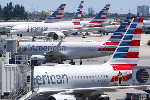 (AP Photo/Wilfredo Lee). In this Wednesday, April 24, 2019, photo, American Airlines aircraft are shown parked at their gates at Miami International Airport in Miami. American Airlines is accusing its mechanics and their unions of conducting an illegal...