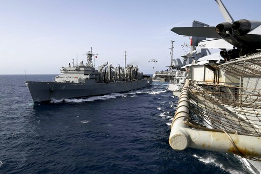 (Mass Communication Specialist 3rd Class Jeff Sherman/U.S. Navy via AP). ADDS LOCATION - In this Sunday, May 19, 2019, photo released by the U.S. Navy, the fast combat support ship USNS Arctic transports cargo to the Nimitz-class aircraft carrier USS A...