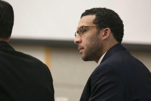 (John Gibbins/The San Diego Union-Tribune via AP, Pool). Former NFL football player Kellen Winslow Jr. looks at attorney Marc Carlos during his rape trial, Monday, May 20, 2019, in Vista, Calif.