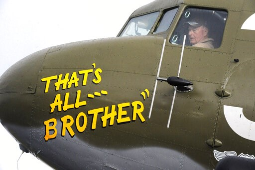 (AP Photo/Jay Reeves). In this April 9, 2019, photo, Pilot Tom Travis sits in the cockpit of the World War II troop carrier That's All, Brother during a stop in Birmingham, Ala. The C-47 aircraft, which led the main Allied invasion of Europe on June 6,...