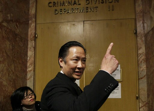 (AP Photo/Jeff Chiu, File). FILE - In this March 28, 2012 file photo, San Francisco Public Defender Jeff Adachi enters a courtroom at the Hall of Justice in San Francisco. A freelance journalist is vowing to protect his source after San Francisco polic...