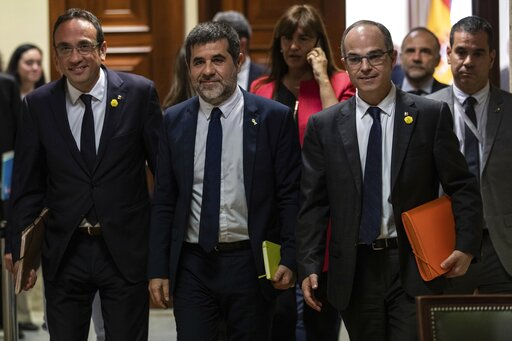 (AP Photo/Bernat Armangue). Catalan politicians Josep Rull, left, Jordi Sanchez and Jordi Turull, right, leave after collecting their credentials at the Spanish parliament in Madrid, Spain, Monday, May 20, 2019. The five separatist leaders on trial for...
