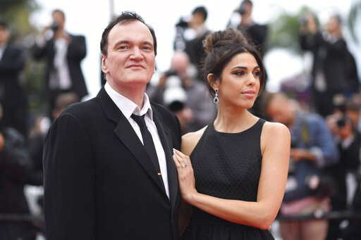 (Photo by Arthur Mola/Invision/AP). Film director Quentin Tarantino and his wife Daniela Pick pose for photographers upon arrival at the premiere of the film 'The Wild Goose Lake' at the 72nd international film festival, Cannes, southern France, Saturd...