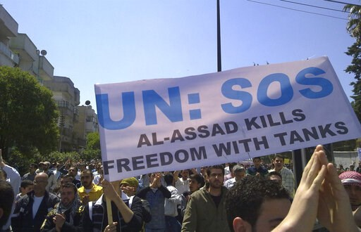 (AP Photo, File). FILE - In this May 6, 2011, citizen journalism file image made on a mobile phone, Syrian anti-government protesters carry a banner during a rally in the central city of Homs, Syria. The Syria Justice and Accountability Center, a Washi...
